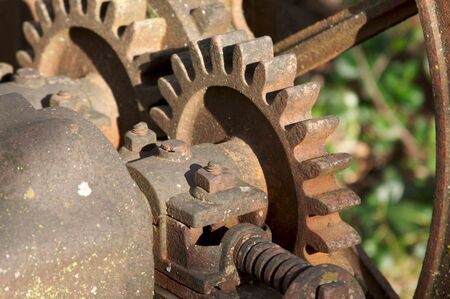farm equipment: Vintage Rusty Farm Equipment Gears Stock Photo