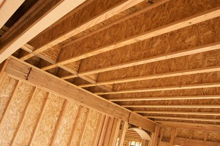 housing lot: New residential construction home framing against a deep blue sky. Stock Photo