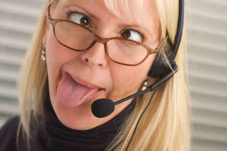 contact center: Goofy businesswoman talks on her phone headset.