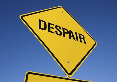 woe: Despair road sign with deep blue sky background.