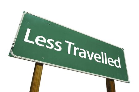 travelled: Less Travelled road sign isolated on white. Contains clipping path.