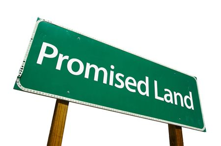 Promised Land road sign isolated on white. Contains clipping path. photo