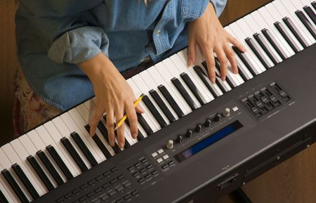 Woman's Fingers with Pencil on Digital Piano Keys Stock Photo - 2676425
