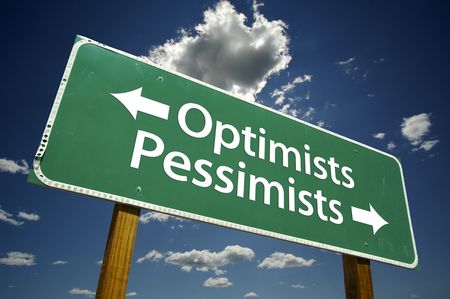 pessimist: Optimists, Pessimists road sign with dramatic blue sky and clouds.
