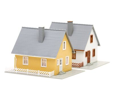 Pair of small houses isolated on a white background. photo