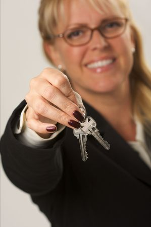 Female presenting keys. Narrow depth of field. photo