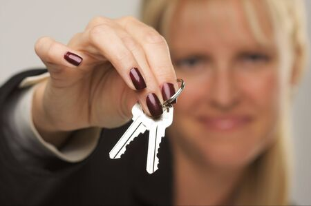 Female presenting keys. Narrow depth of field. Stock Photo - 2718930