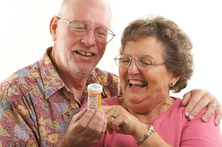 Senior Couple reads a prescription bottle. photo