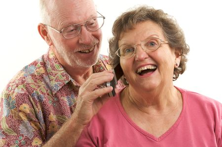 Senior Couple using a cell phone. photo