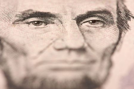 Abstract Macro of U.S. Five Dollar Bills Abraham Lincoln face with Narrow Depth of Field. photo