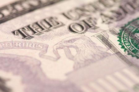 Abstract Macro of U.S. Five Dollar Bill with Narrow Depth of Field. photo