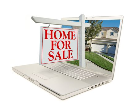 Home for Sale Sign & New Home on Laptop isolated on a white Background. Foto de archivo