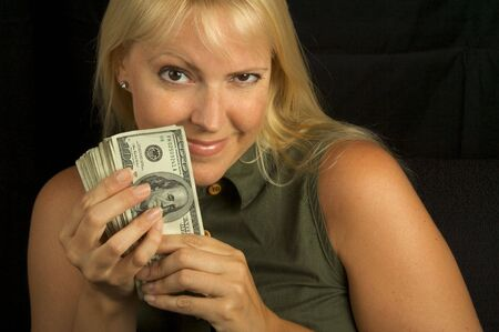 Attractive Woman Excited About her Stack of Money She Holds. Stock Photo - 3223252