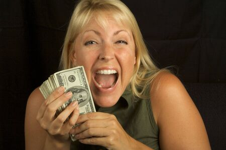 Attractive Woman Excited About her Stack of Money She Holds. Stock Photo - 3223251
