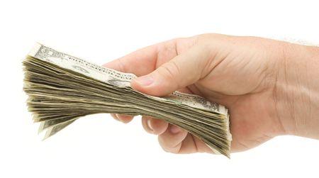 cash in hand: Entrega sobre dinero aislada sobre un fondo blanco.