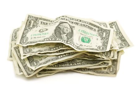 Pile of Crumpled Dollar Bills Isolated on a White Background. photo