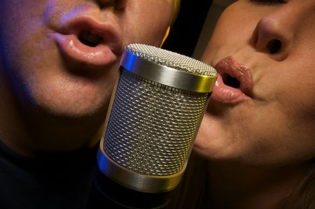 Couple Singing Duet at Condenser Microphone. photo