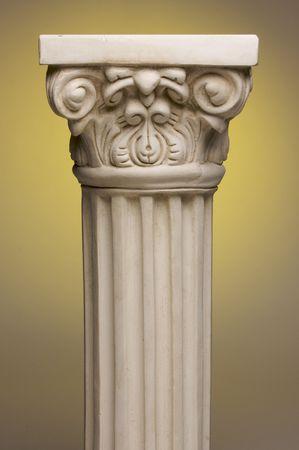 gradation: Ancient Column Pillar Replica on a Yellow Gradation Background.