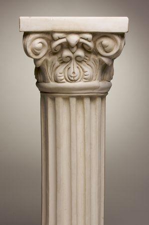 gradation: Ancient Column Pillar Replica on a Grey Gradation Background.