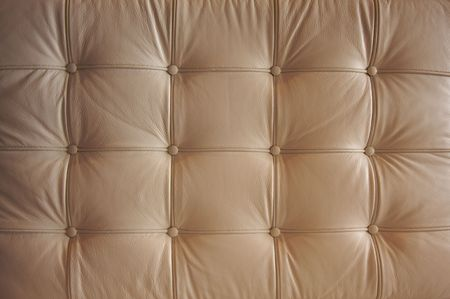 comfortable: Comfortable Buttoned Leather Pattern with dramatic lighting. Stock Photo