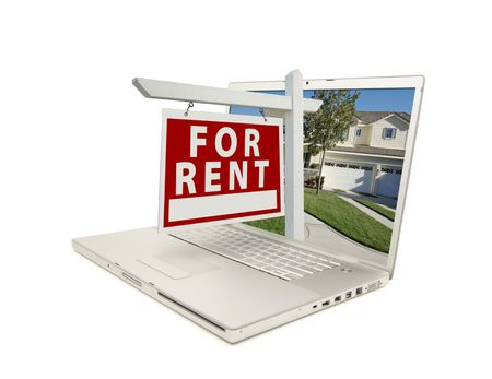 For Rent Sign & New Home on Laptop isolated on a white Background. Stock Photo