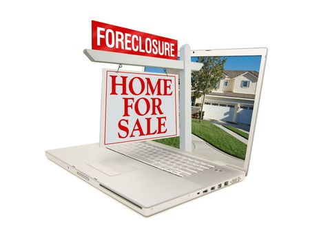 repossession: Foreclosure Home for Sale Sign & New Home on Laptop isolated on a white Background. Stock Photo