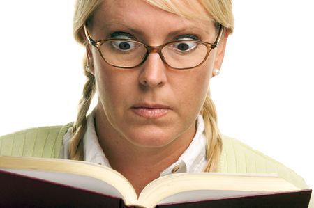 stunned: Stunned Female with Ponytails and Book isolated on a White Background. Stock Photo