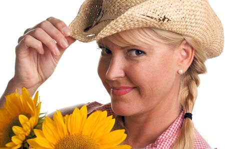 Attractive Blond with Cowboy Hat and Sunflower Isolated on a White Background. photo