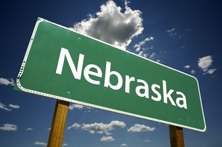 nebraska: Nebraska Road Sign with dramatic clouds and sky.