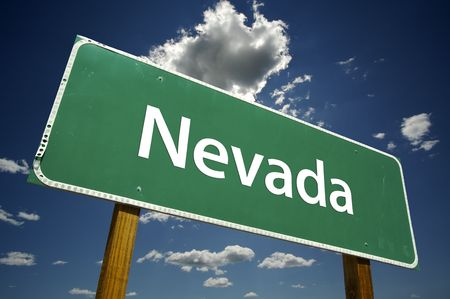 nevada: Nevada Road Sign with dramatic clouds and sky. Stock Photo