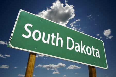 dakota: South Dakota Road Sign with dramatic clouds and sky.