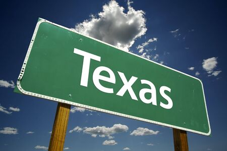 Texas Road Sign with dramatic clouds and sky. Stock Photo