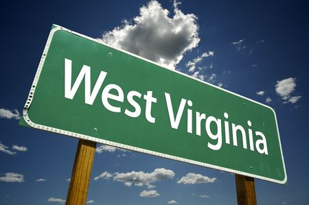 west virginia: West Virginia Road Sign with dramatic clouds and sky.