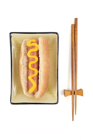 east meets west: East Meets West - Hot Dog and Chopsticks Isolated on a White Background. Stock Photo
