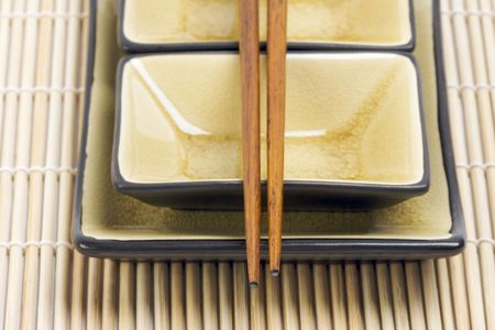 Abstract Chopsticks and Bowls with Narrow Depth of Field.  photo