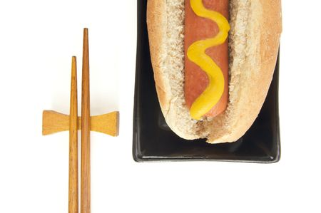 east meets west: East Meets West - Hot Dog and Chopsticks Isolated on a White Background