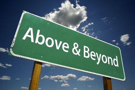 decision: Above and Beyond Road Sign with dramatic clouds and sky.