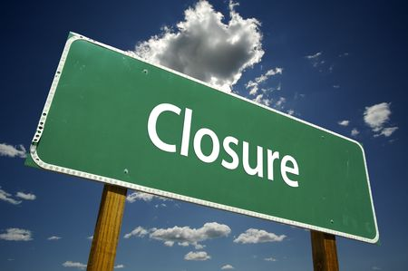 closure: Closure Road Sign with dramatic clouds and sky. Stock Photo