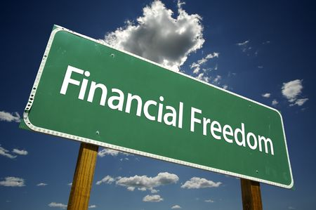 financial freedom: Financial Freedom Road Sign with dramatic clouds and sky.