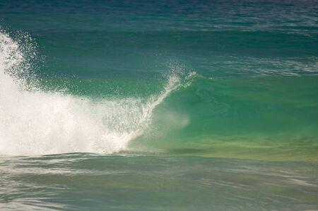 shorebreak: Dramatic Shorebreak Wave on a clear morning.