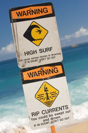 currents: Surf and Currents Warning Sign on a beach in Hawaii Stock Photo