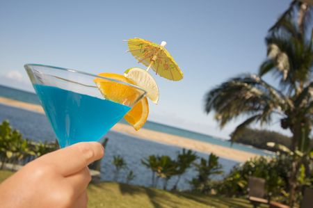 Woman with Tropical Drinks on Lanai photo