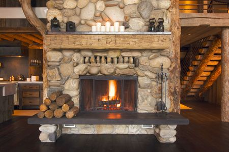 fireplace: Rustic Fireplace in Log Cabin