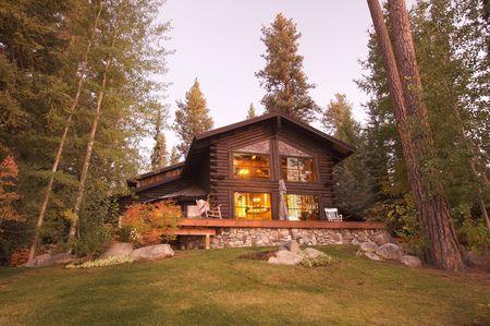 Beautiful Log Cabin Exterior Among Pine Trees photo
