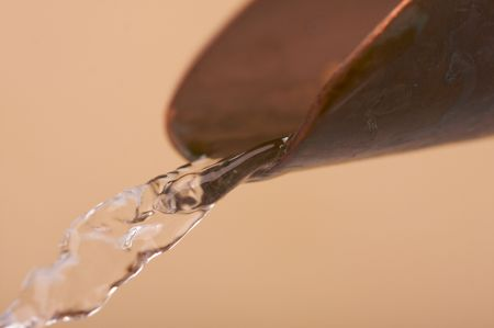 Custom Copper Faucet and Water Close-up. Stock Photo - 3714481