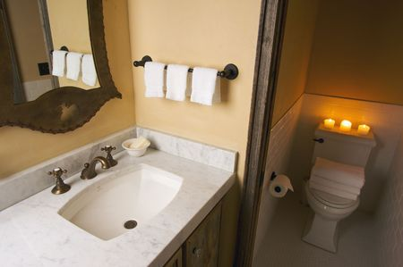 bathroom mirror: Rustic Bathroom Sink and Toilet Scene