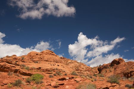 Red Rocks of Utah with Dramatic Blue Sky and Clouds Stock Photo - 3714512