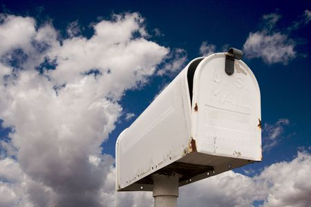 Weathered Old Mailbox Against Blue Sky and Clouds Stock Photo - 3735063