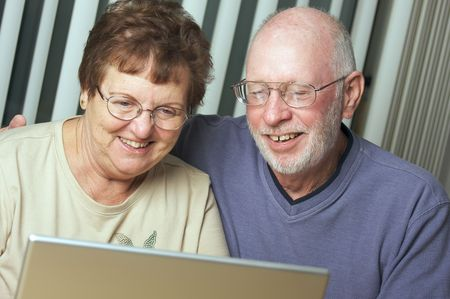 baby boomer: Senior Adults on Working on a Laptop Computer