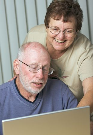 Senior Adults on Working on a Laptop Computer photo